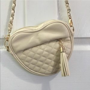 heart shaped quilted cross body